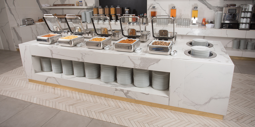 InductWarm® – keep food warm invisibly with inductive undercounter devices