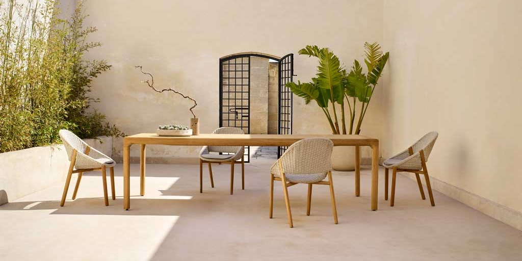 Tribù updates its classic Illum table with a sculpted teak version
