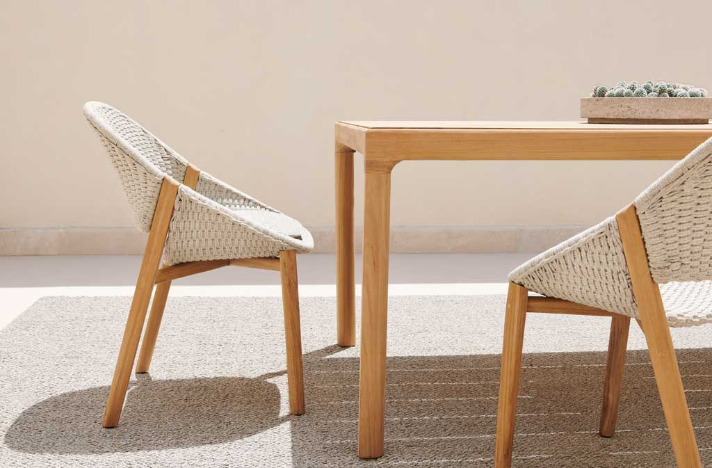 Elio-armchair-Illum-dining-table-teak_closeup