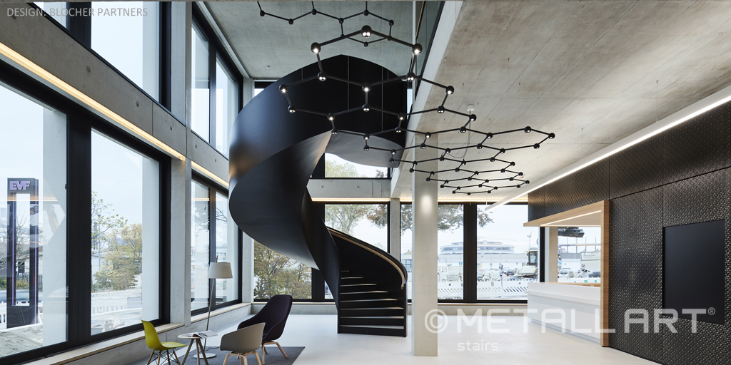 Breath-taking sculptural stair design with steel soffit lining by MetallArt